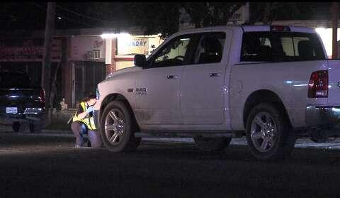 Woman crossing street fatally struck by 2 pickup trucks late