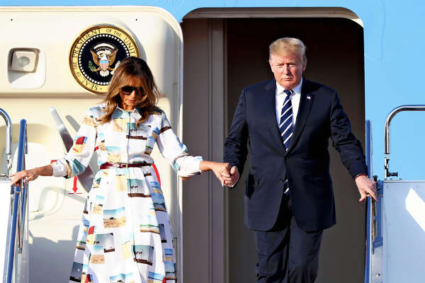 President Donald Trump and first lady Melania Trump arrie at Tokyo's Haneda Airport on Saturday.