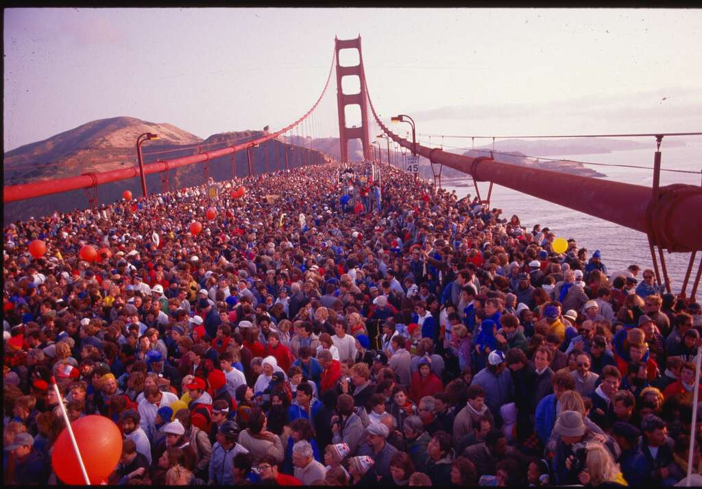 <p>Hundreds of thousands of people crowded onto the Golden Gate Bridge to celebrate its 50th anniversary. San Francisco, California, May 24, 1987.</p>
