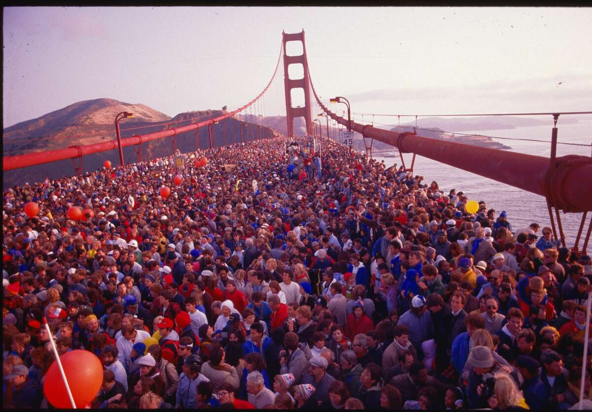 Hundreds of thousands of people crowded onto the Golden Gate Bridge to celebrate its 50th anniversary. San Francisco, California, May 24, 1987.