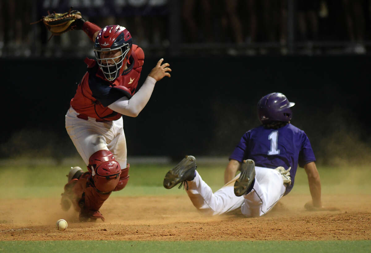 Atascocita catcher Tyler Byrd tries to find the ball after failing to make a play on Ridge Point baserunner Preston Steszewski (1) during the bottom of the 5th inning of game two of their Region III-6A Semi-final playoff matchup at Ridge Point High School on May 24, 2019.