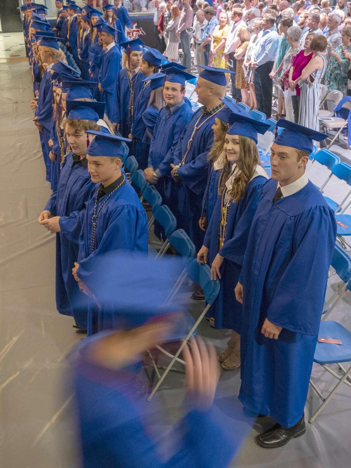 Midland Christian seniors process in 05/24/19 evening for graduation ceremonies at McGraw Event Center. Tim Fischer/Reporter-Telegram