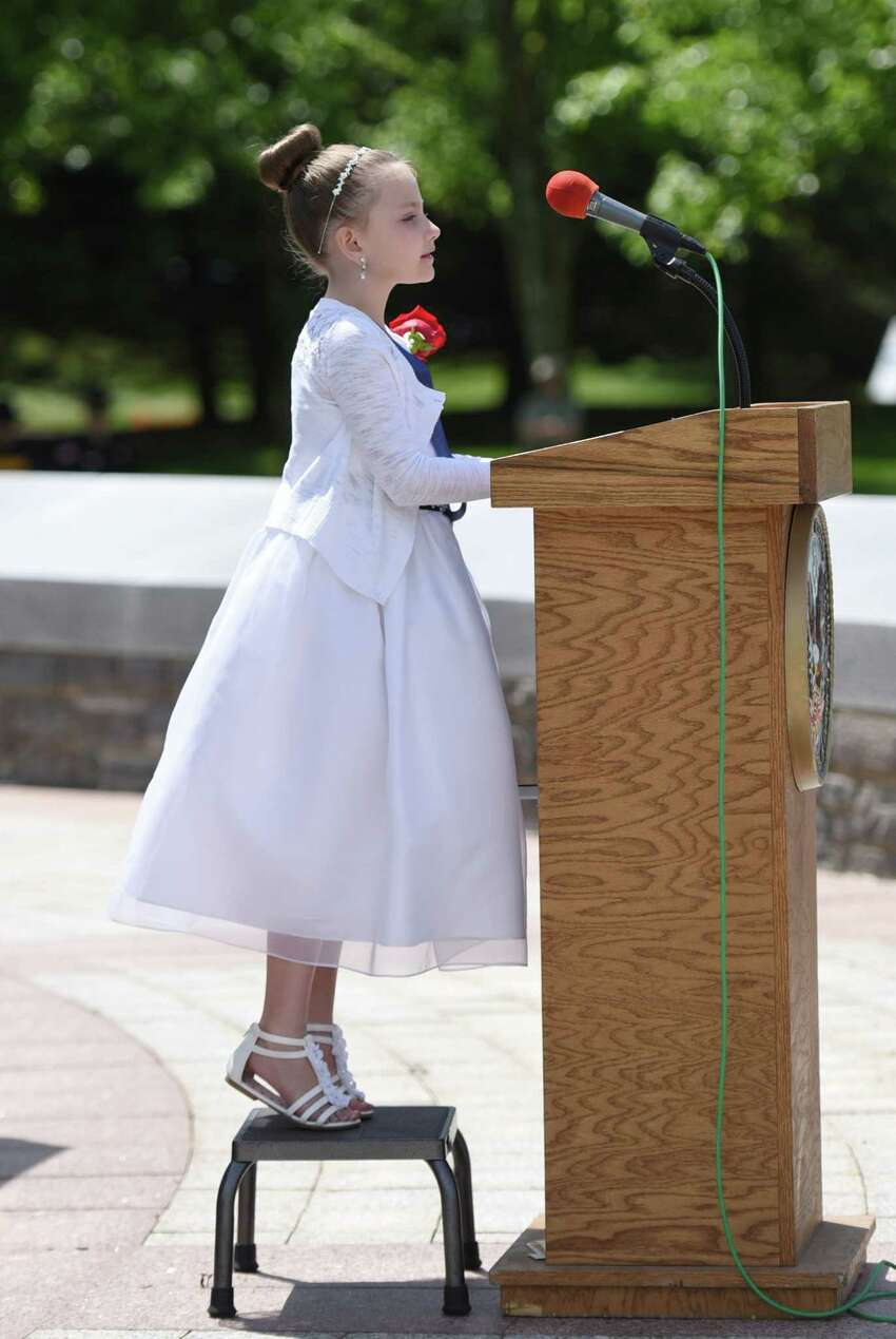 Poppy queen Gianna Sheehan recites the Flander's Field during the Gerald B.H. Solomon Saratoga National Cemetery 20th Annual Memorial Day Ceremony on Saturday, May 25, 2019 at Saratoga National Cemetery in Schuylerville, NY. (Phoebe Sheehan/Times Union)