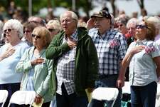 Attendees sing along to the national anthem during the Gerald B.H. Solomon Saratoga National Cemetery 20th Annual Memorial Day Ceremony on Saturday, May 25, 2019 at Saratoga National Cemetery in Schuylerville, NY. (Phoebe Sheehan/Times Union)