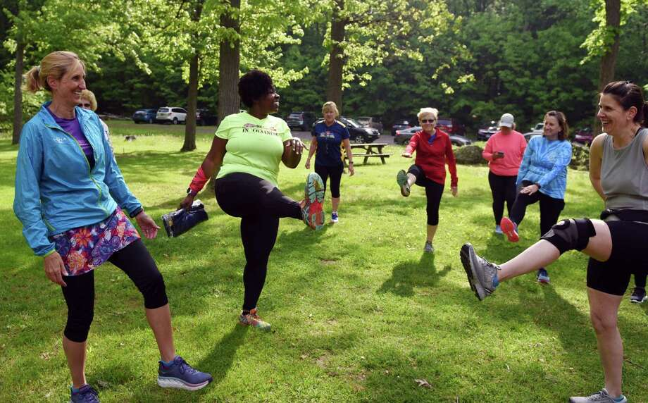 "Freihofer's ""ambassador"" Olivia Frempong helps to lead a warmup during Freihofer's Run for Women Training Challenge session on Saturday, May 25, 2019 at Town of Colonie Mohawk River Park in Cohoes, NY. (Phoebe Sheehan/Times Union) Photo: Phoebe Sheehan, Albany Times Union / 20047038A"