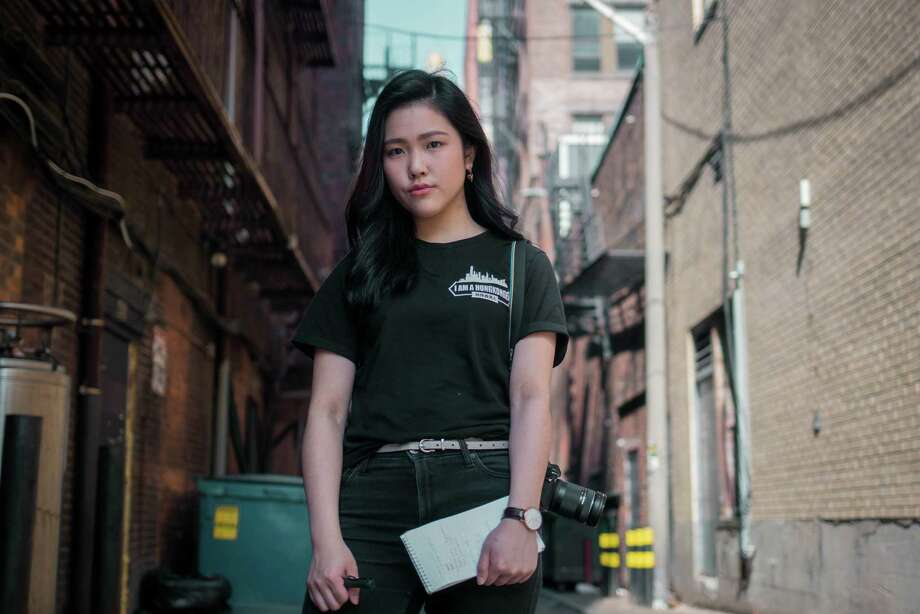 "Frances Hui poses for a photo at Emerson College's library in Boston. The student penned a column title ""I am from Hong Kong, not China,"" which generated backlash from Chinese students. Photo: Andrew Baicker / Andrew Baicker"
