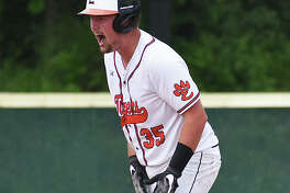 Edwardsville catcher Jacob Kitchen celebrates after his two-run double in the third inning against Alton in the Class 4A Alton Regional championship game on Saturday.
