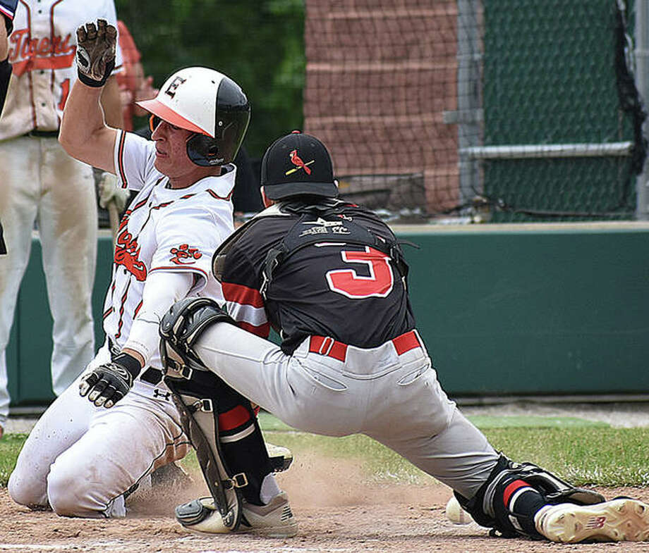 Edwardsville's Joe Copeland, left, slides safely into home ahead of the tag by Alton catcher Owen Stendeback in the Class 4A Alton Regional championship game on Saturday at AHS. Photo: Matt Kamp, Intelligencer | For The Telegraph