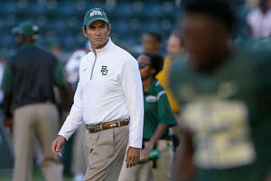 FILE - In this Sept. 12, 2015, file photo, Baylor coach Art Briles walks the field before the NCAA college football team's game against Lamar in Waco, Texas. Briles, the former Baylor football coach fired three years ago after an investigation found the school had mishandled allegations of sexual misconduct and violence, has been hired to lead an East Texas high school program. Mount Vernon Superintendent says its board of trustees has approved a two-year contract with Briles, who was 65-37 in eight seasons with Baylor. Before coaching in college, Briles had a successful 20-year career as a high school coach in Texas. (AP Photo/LM Otero, File)