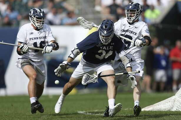 Yale's Christian Cropp (34) loses his stick under pressure from Penn State's Brian Townsend (19) during a semifinal game in the NCAA Division I men's lacrosse tournament at Lincoln Financial Field in Philadelphia, Saturday, May 25, 2019. (Tim Tai/The Philadelphia Inquirer via AP)