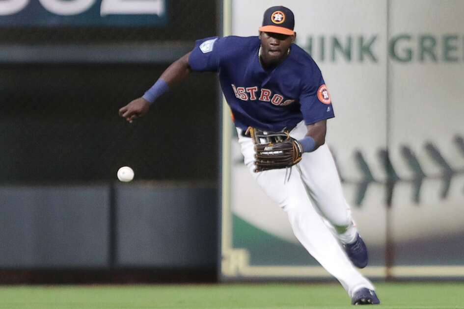 Houston Astros outfielder Yordan Alvarez (72) fields a ball during the eighth inning of a spring training game at Minute Maid Park on Monday, March 25, 2019, in Houston.