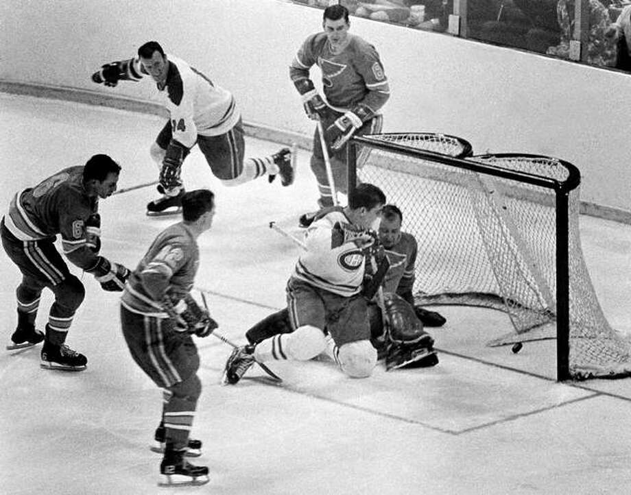 In this May 7, 1968, file photo, Montreal's Serge Savard is about to land in the lap of Blues' goalie Glenn Hall as the puck spins into the net for the winning goal in the NHL Stanley Cup finals at The Arena in St. Louis. The Blues made the Stanley Cup Finals in their first three seasons, but lost in sweeps to the Canadiens in 1968 and 1969 and the Bruins in 1970. Photo: AP File Photo