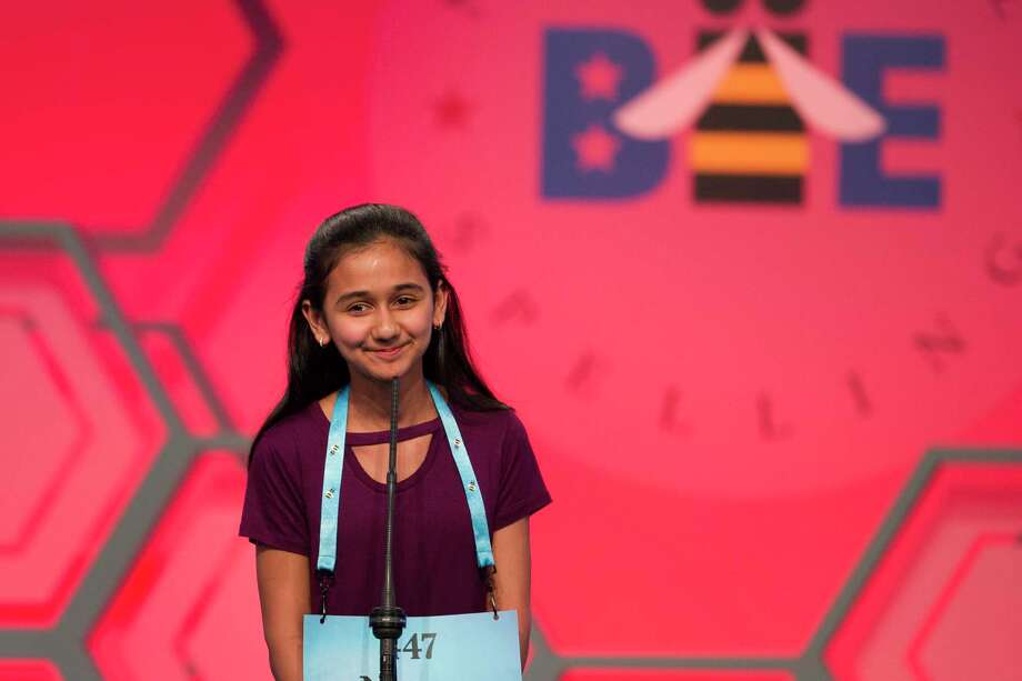 "FILE - In this May 31, 2018 file photo, Naysa Modi, 12, from Frisco, Texas, spells her word incorrectly during the evening finals of the Scripps National Spelling Bee in Oxon Hill, Md.  An unremarkable sound can be the toughest thing for spellers to master at the Scripps National Spelling Bee. It's known as the schwa. It sounds like ""Uh,"" and any vowel can make the sound.   Spellers have a variety of techniques to figure out unfamiliar schwas,  but none of the strategies is foolproof, and sometimes the only things to do are to memorize the word or guess.  (AP Photo/Cliff Owen) Photo: Cliff Owen / FR170079 AP"