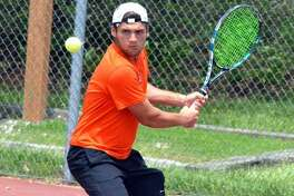 Edwardsville senior Seth Lipe makes a backhand return in his No. 1 doubles match during the Class 2A Edwardsville Sectional on May 18.