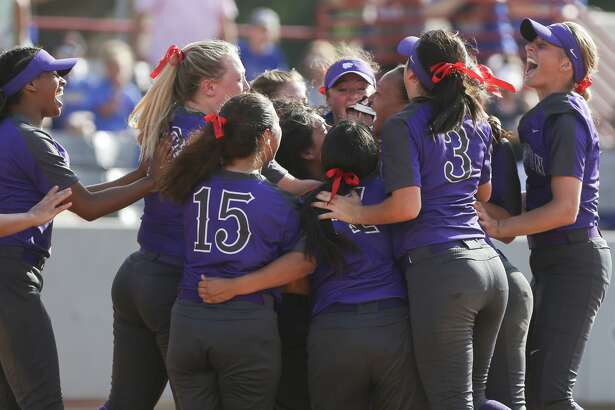 Angleton players gather around staring pitcher Aaliyah Garcia to celebrate their 9-8 victory over Barbers Hill in Game 3 of regional final series at Cougar Softball Stadium on Saturday, May 25, 2019, in Houston. Angleton advanced to state tournament while Garcia pitched through seven innings.
