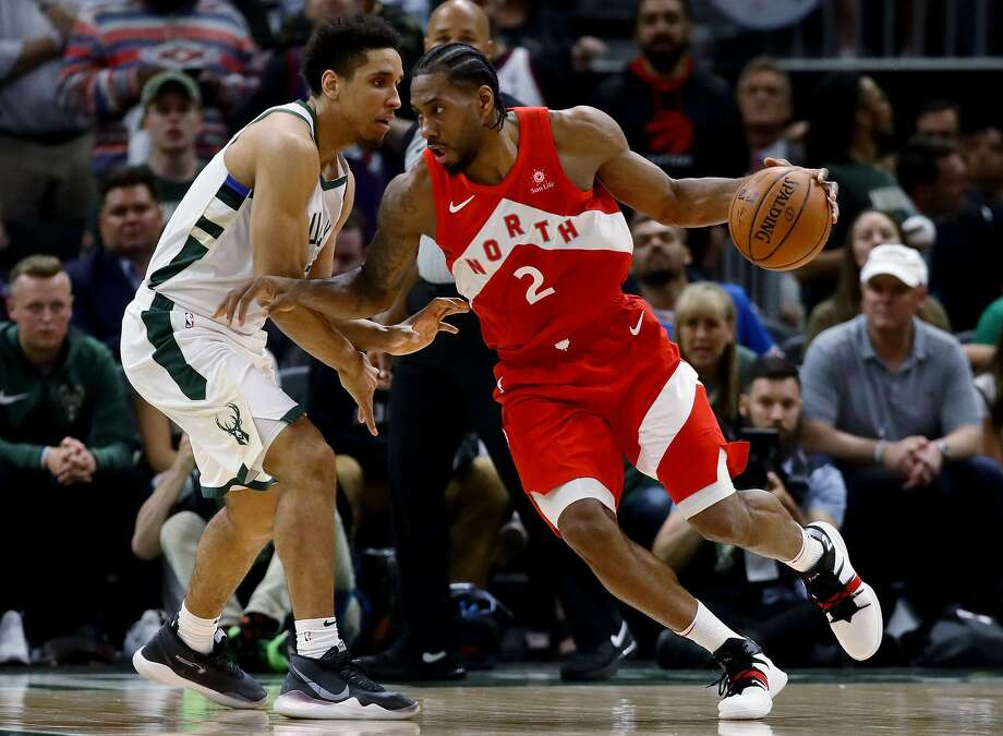 0bb3691cb51 Kawhi Leonard  2 of the Toronto Raptors dribbles the ball while being  guarded by Malcolm