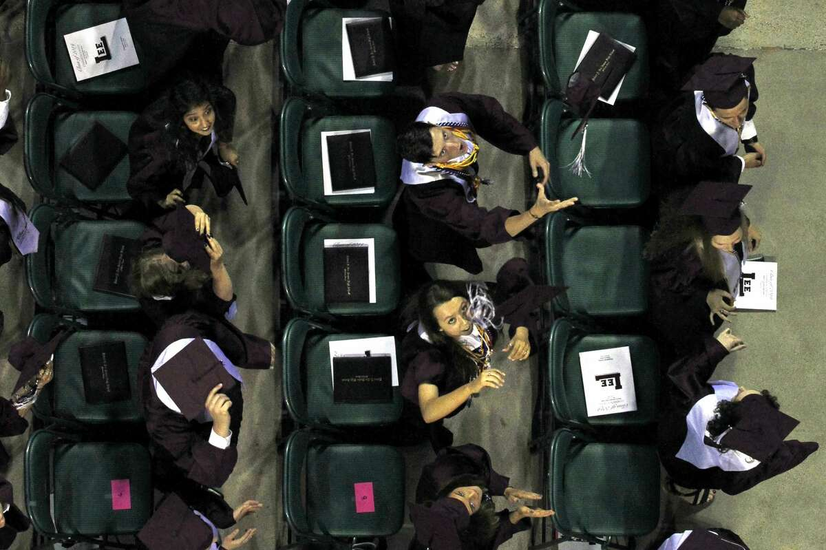 Lee High School graduates throw their caps during the commencement ceremony May 25, 2019 at Chaparral Center. James Durbin/Reporter-Telegram