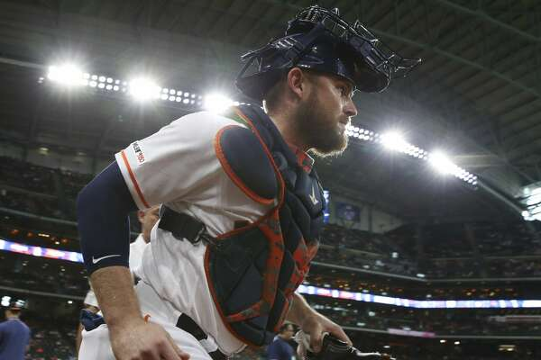 Houston Astros catcher Max Stassi (12) goes toward the bullpen to warm up before the gane against the Texas Rangers at Minute Maid Park on Sunday, May 12, 2019, in Houston.