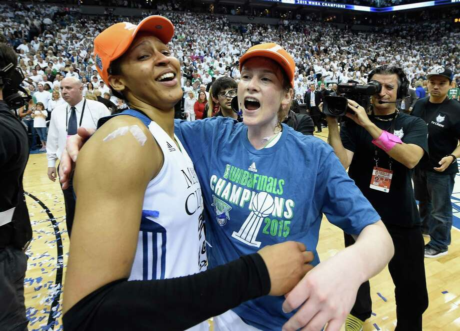 Maya Moore #23 and Lindsay Whalen #13 of the Minnesota Lynx celebrate a win in Game Five of the 2015 WNBA Finals against the Indiana Fever on October 14, 2015 at Target Center in Minneapolis, Minnesota. The Lynx defeated the Fever 69-52 to win the WNBA Championship. (Photo by Hannah Foslien/Getty Images) Photo: Hannah Foslien / 2015 Getty Images