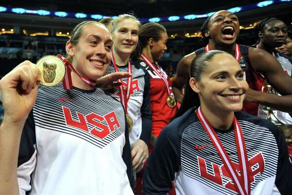 (From L) USA's Breanna Stewart, Lindsay Whalen, Diana Taurasi and Nnemkadi Ogwumike pose with their gold medals after winning the 2014 FIBA Women's World Championship final basketball match between Spain and USA at Fenerbahce Ulker Sports Arena on October 5, 2014 in Istanbul. AFP PHOTO / OZAN KOSEOZAN KOSE/AFP/Getty Images ORG XMIT: 3746