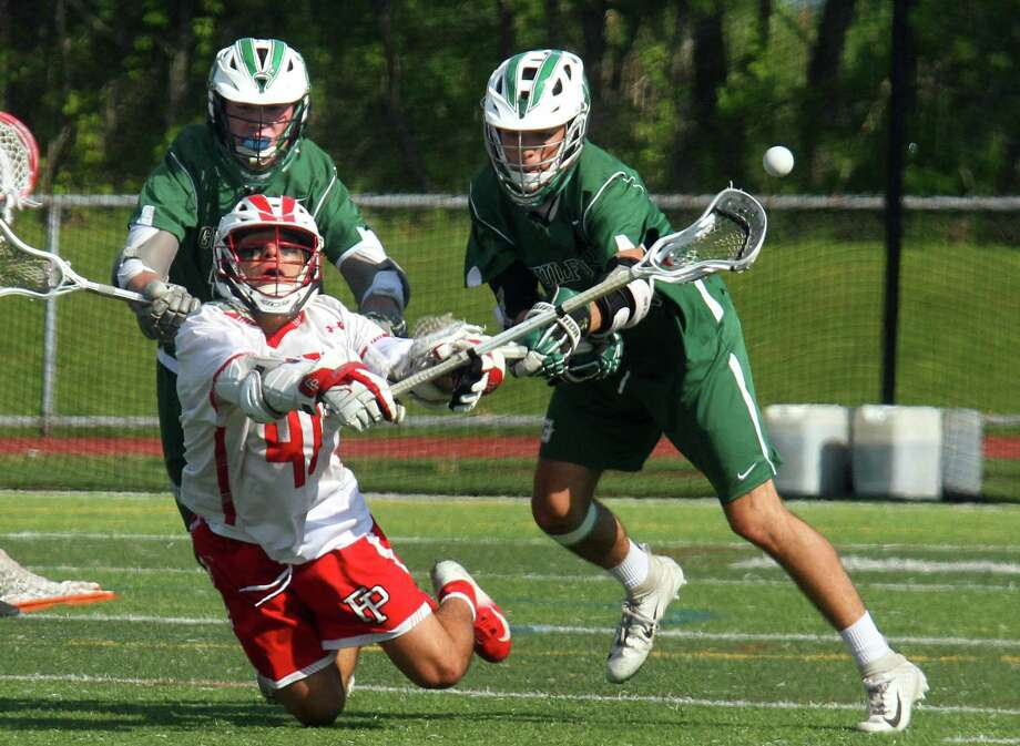 Fairfield Prep's Ethan Grandolfo (41) looses control of the ball during SCC Boys Lacrosse Championship action against Guilford in West Haven, Conn., on Saturday May 25, 2019. Photo: Christian Abraham / Hearst Connecticut Media / Connecticut Post