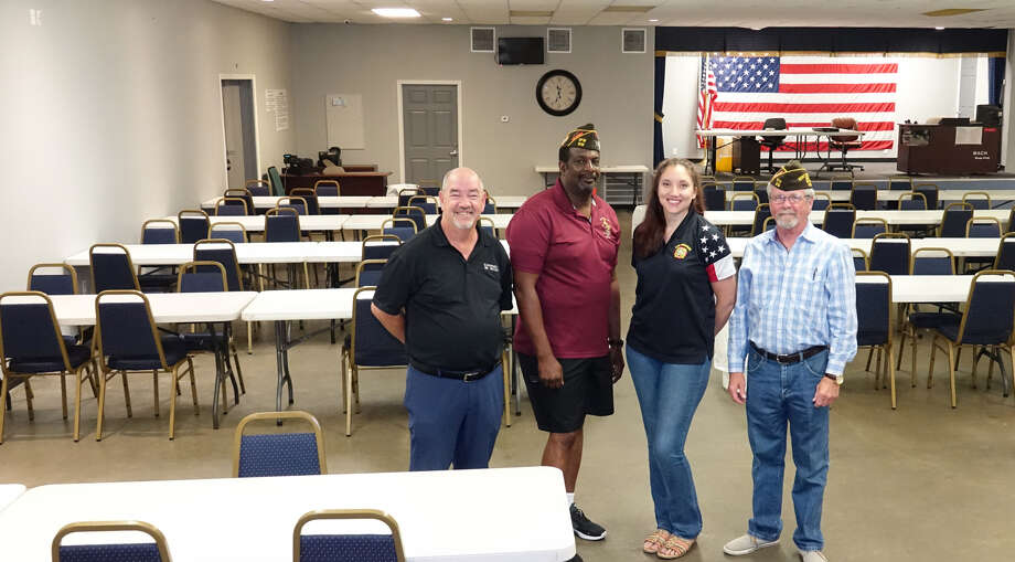 Baytown's Veterans of Foreign Wars Post 912 was inundated by Hurricane Harvey record rainfall. Those diving in to help with restoration efforts included, left to right, Jim Wadzinsky, Community Auto Group; Harold Sams, post commander; Rebecca Silva, post member and Jerry Johnson, senior vice commander of the post. Photo: Jeff Yip