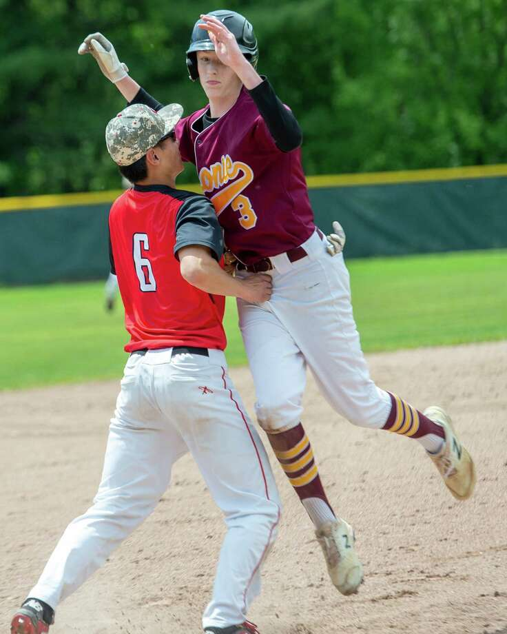 Colonie baserunner Patrick Reilly is tagged out by Guilderland third baseman Henry Li during the Section II, Class AA quarterfinals at Dutchmen Field in Guilderland on Saturday, May 25, 2019 (Jim Franco/Special to the Times Union.) Photo: James Franco / 20047041A