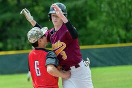 Colonie baserunner Patrick Reilly is tagged out by Guilderland third baseman Henry Li during the Section II, Class AA quarterfinals at Dutchmen Field in Guilderland on Saturday, May 25, 2019 (Jim Franco/Special to the Times Union.)