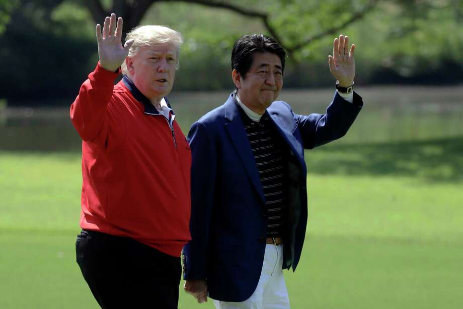 President Donald Trump and Japanese Prime Minister Shinzo Abe wave before playing a round of golf at Mobara Country Club, Sunday, May 26, 2019, in Chiba, Japan. (AP Photo/Evan Vucci) Photo: Evan Vucci / Copyright 2019 The Associated Press. All rights reserved.