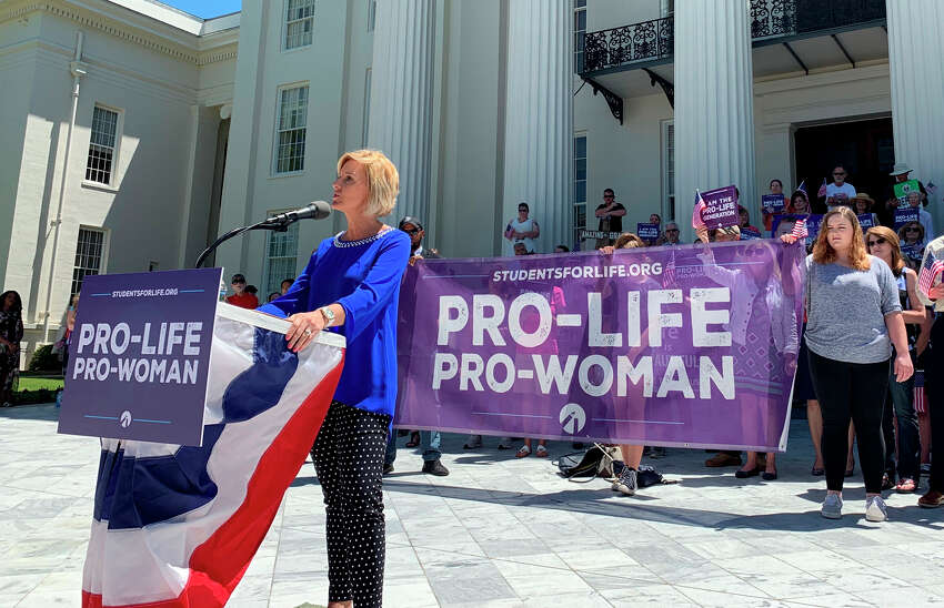 In this May 22, 2019, photo, Beck Gerritson, president of Eagle Forum of Alabama, speaks at an anti-abortion rally outside the Capitol in Montgomery, Ala. Members of both parties say a flood of laws banning abortions in Republican-run states has handed Democrats a daunting weapon for next year?s elections. They say the restrictions will help Democrats paint the GOP as extreme and woo centrist voters who could decide tight House and Senate races. (AP Photo/Kim Chandler)