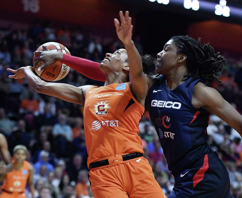 Mystics guard Shatori Walker-Kimbrough, right, blocks a shot attempt by Sun guard Jasmine Thomas on Saturday in Uncasville. Photo: Sean D. Elliot / The Day Via AP / 2019 The Day Publishing Company