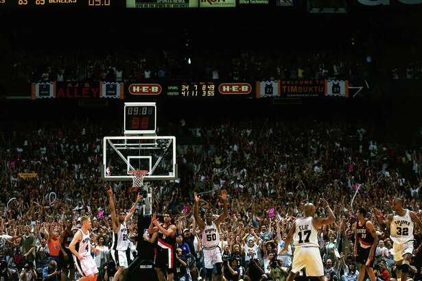 Sean Elliott celebrates after hitting the game-winning shot against the Portland Trail Blazers during Game 2 of the 1999 Western Conference Finals at the Alamodome.