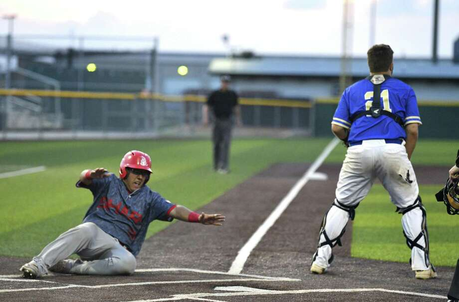Mission Sharyland's Juan Lopez scores to take the lead over Kerrville Tivy during Game 3 of the Class 5A Regional Semifinal in Corpus Christi on Friday, May 24, 2019. Photo: Billy Calzada, Staff / Staff Photographer / Billy Calzada