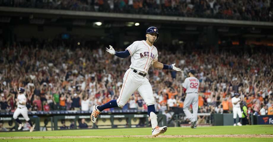 Houston Astros' Carlos Correa (1) celebrates after hitting the game-winning single against the Boston Red Sox during the ninth inning of a baseball game Saturday, May 25, 2019, in Houston. The Astros won 4-3. Photo: Marie D. De Jesús / Staff Photographer