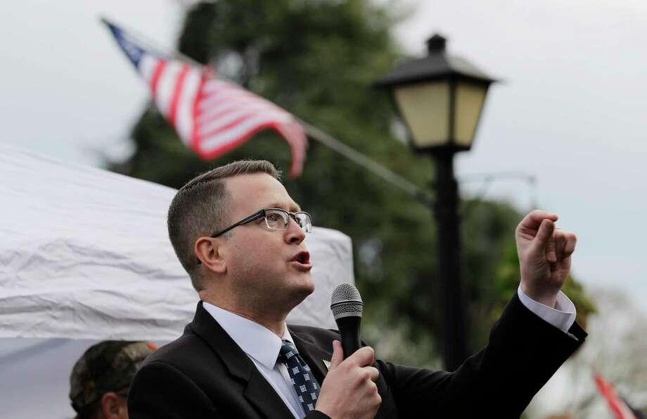 """FILE - In this Jan. 18, 2019, file photo, Rep. Matt Shea, R-Spokane Valley, speaks at a gun-rights rally at the Capitol in Olympia, Wash. Recently published internet chats from 2017 show Shea and three other men discussing confronting """"leftists"""" with a variety of tactics, including violence, surveillance and intimidation. The messages prompted Washington House Democrats to demand that Shea be reprimanded for a history of far-right speech and activities. (AP Photo/Ted S. Warren, File) Photo: Ted S. Warren / Copyright 2019 The Associated Press. All rights reserved."""
