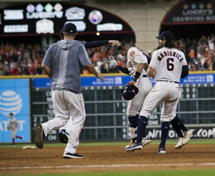 Houston Astros shortstop Carlos Correa (1) and his teammates celebrate the victory against the Boston Red Sox 4-3 on Saturday, May 25, 2019, in Houston.