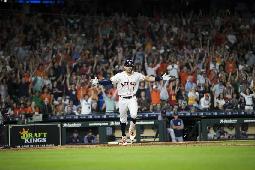 Houston Astros' Carlos Correa (1) celebrates after hitting the game-winning single against the Boston Red Sox during the ninth inning of a baseball game Saturday, May 25, 2019, in Houston. The Astros won 4-3.