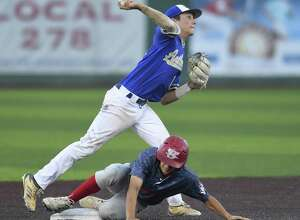 Kerrville Tivy's Stoney Rhodes turns a double play as Jose Garcia of Mission Sharyland slides in during Game 3 of the Class 5A Regional Semifinal in Corpus Christi on Friday, May 24, 2019.