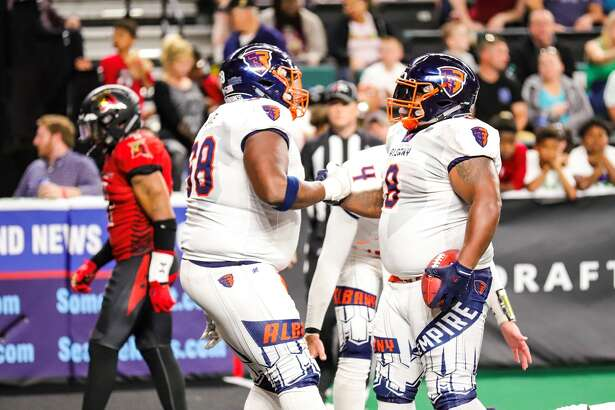 Ryan Cave and Terence Moore of Albany celebrate a play in the Empire's victory over the Atlantic City Blackjacks on Saturday at Jim Whelan Boardwalk Hall in Atlantic City, N.J. (Courtesy of Atlantic City Blackjacks)