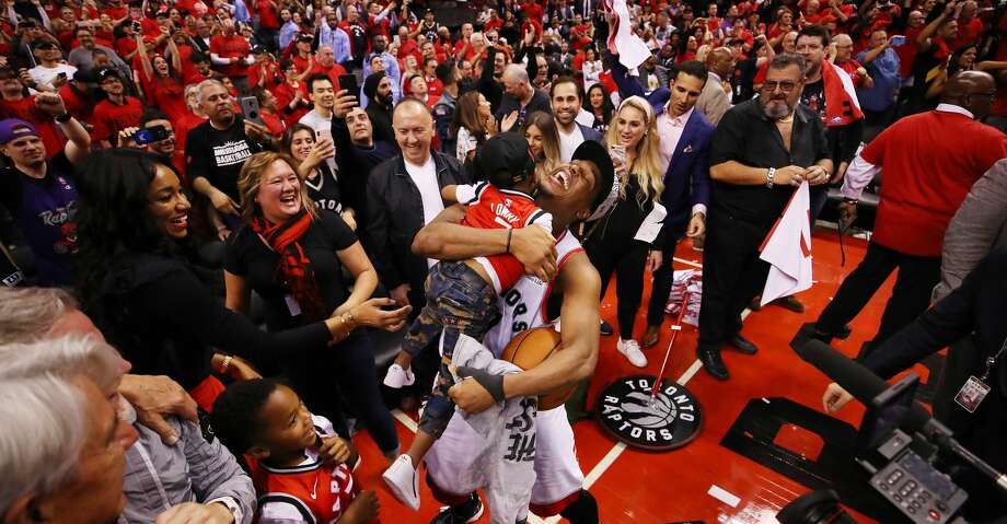 TORONTO, ONTARIO - MAY 25: Kyle Lowry #7 of the Toronto Raptors celebrates with his sons Kameron and Karter after defeating the Milwaukee Bucks 100-94 in game six of the NBA Eastern Conference Finals to advance to the 2019 NBA Finals at Scotiabank Arena on May 25, 2019 in Toronto, Canada. NOTE TO USER: User expressly acknowledges and agrees that, by downloading and or using this photograph, User is consenting to the terms and conditions of the Getty Images License Agreement. (Photo by Gregory Shamus/Getty Images) Photo: Gregory Shamus/Getty Images