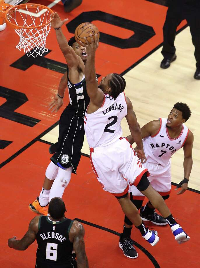TORONTO, ONTARIO - MAY 25: Kawhi Leonard #2 of the Toronto Raptors dunks the ball during the second half against Giannis Antetokounmpo #34 of the Milwaukee Bucks in game six of the NBA Eastern Conference Finals at Scotiabank Arena on May 25, 2019 in Toronto, Canada. NOTE TO USER: User expressly acknowledges and agrees that, by downloading and or using this photograph, User is consenting to the terms and conditions of the Getty Images License Agreement. (Photo by Claus Andersen/Getty Images) Photo: Claus Andersen / 2019 Getty Images