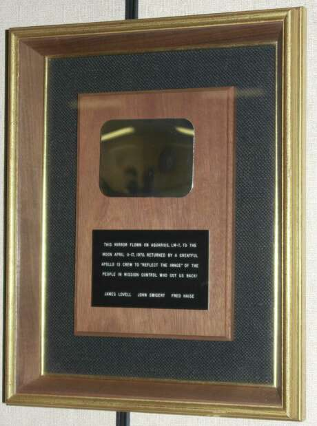 """The mirror the Apollo 13 crew presented presented to mission control for helping them survive. The plaque reads """"This mirror flown on Aquarius, LM-7, to the moon April 11-17, 1970. Returned by a greatful Apollo 13 crew to 'reflect the image' of the people in Mission Control who got us back! James Lovell John Swigert Fred Haise."""""""