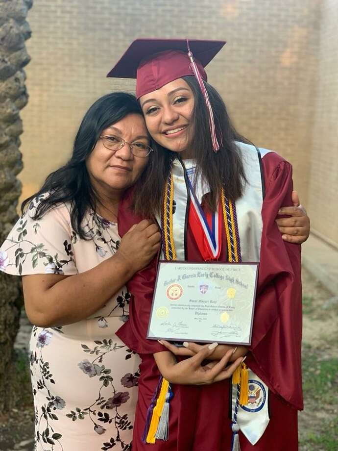 Saraí  Ruiz is shown with her diploma alongside her mother after her graduation from Hector J. Garcia Early College High School.