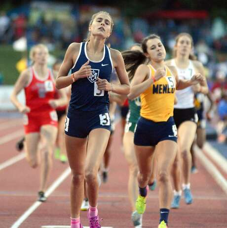Samantha Wallenstrom (Marin Catholic) won in 2:08.78, edging Menlo's Charlott Tomkinson 2:09.41 and Rayna Stanziano of Concord. Last week Wallenstrom went to help Stanziano who had fallen. Wallenstrom passed both girls in the last 75 meters to win. Eric Taylor