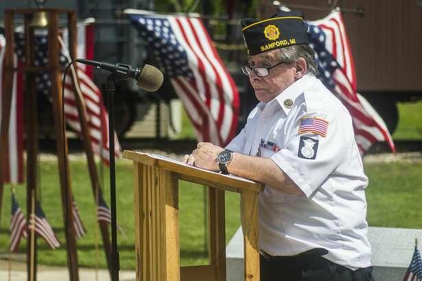 Sanford American Legion Post 443 Commander Mark Authier speaks during a veterans' tribute ceremony on Saturday, May 25, 2019 at the Sanford Centennial Museum. (Katy Kildee/kkildee@mdn.net)