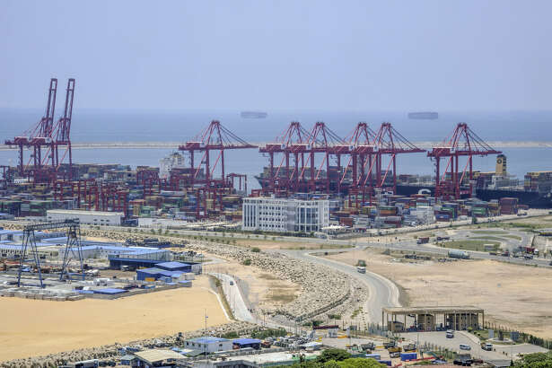 Equipment and materials sit at the site of Colombo Port City, developed by China Harbour Engineering Co., a unit of China Communications Construction Co., foreground, at Port of Colombo in Colombo, Sri Lanka, on March 30, 2018.