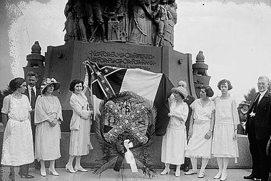 Members of the United Daughters of the Confederacy at the Confederate Memorial in Arlington National Cemetery in 1922. Recent scholarship indicates women in the South may have started the tradition that led to Memorial Day as a national holiday. Photo: Library Of Congress / Library of Congress