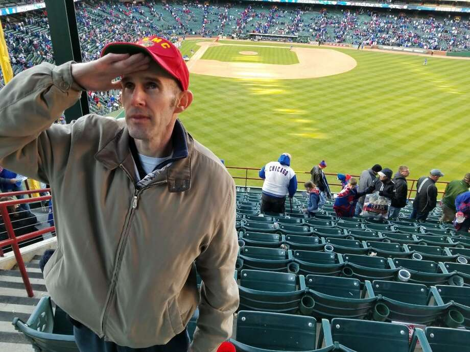 PHOTOS: Stu and Benjamin Duncan Stu Duncan salutes his late father, while wearing his father's Marine Corps hat, at a Texas Rangers game in Arlington in March. Benjamin, a retired 29-year veteran of the U.S. Marine Corps, died in January. Baseball was the pasttime shared by father and son. Photo: Michael Phillips/Courtesy Photo