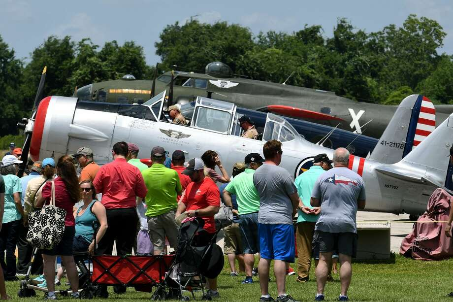 Visitors check out a variety of World War II era aircraft, courtesy of the Texas Raiders, that were on display at Hooks Airport in Spring on May 25, 2019. Photo: Jerry Baker, Houston Chronicle / Contributor / Houston Chronicle