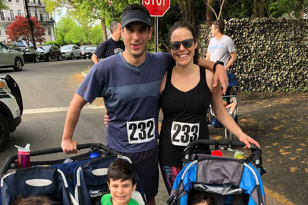 Michael Zelin and wife Lauren Zelin with their children days before Zelin visited the emergency room for soreness in his arm.